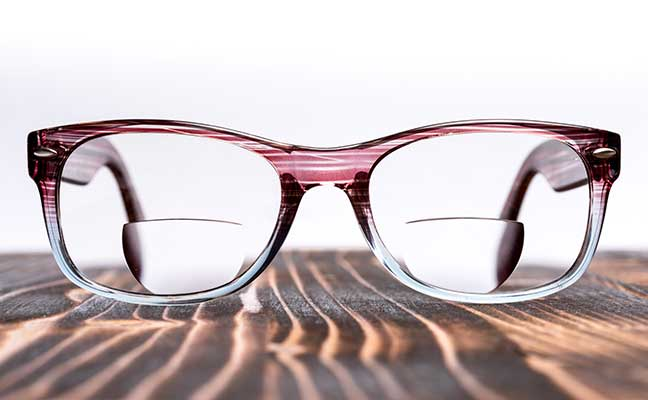 bifocal lenses glasses on a wooden board